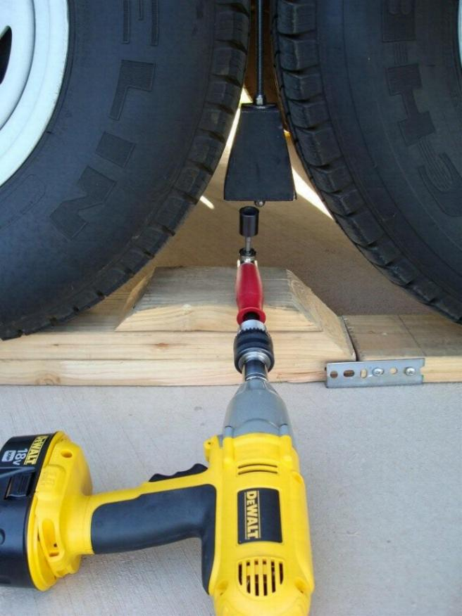 Picture shows the Cowan Chuck being used in a new big rig tire locking device.