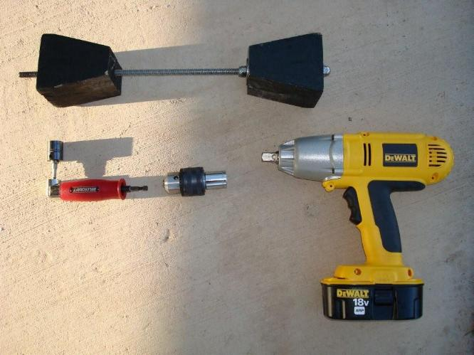 This picture shows the tools needed to use to secure a truck from moving using a Cowan Chuck and an impact wrench.